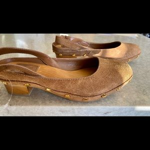 Tory Burch brand almond color leather clogs.